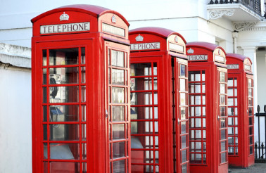 Row of red telephone boxes in London street