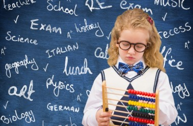 Digital composite image of schoolgirl holding abacus against chalkboard